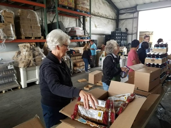 Volunteers serve groceries at Community Food Bank of San Benito County