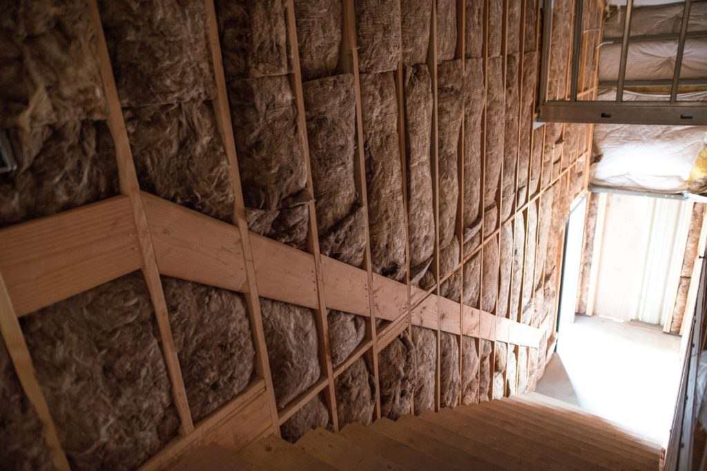 Insulation in walls along stairway