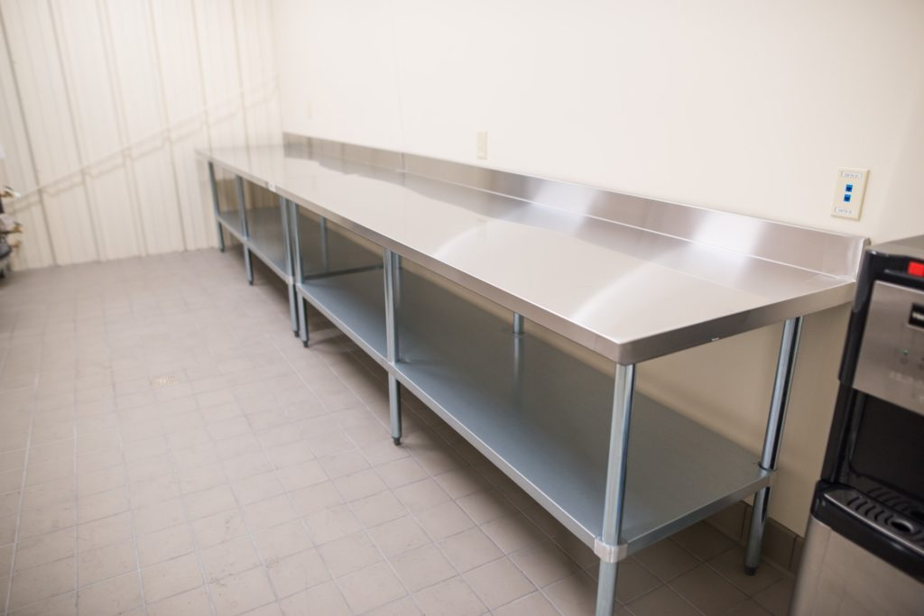 Food Bank of San Benito County features a Food prep table in packaging room