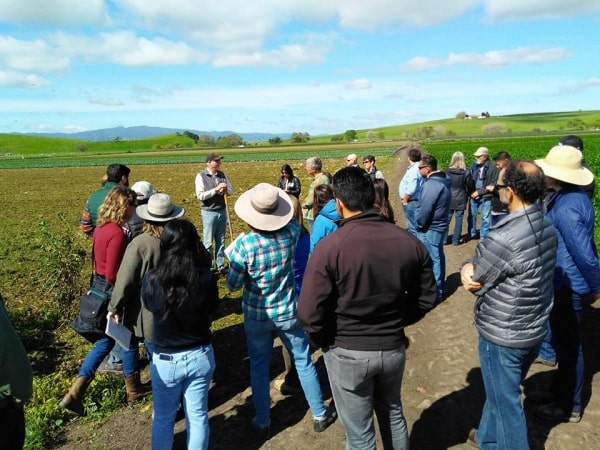 Group listens to Phil Foster during Foster Farm tour April 2019