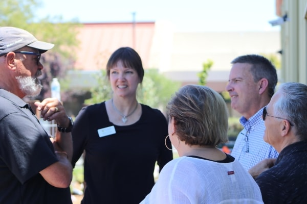 Mark Paxton speaks with others at Community Food Bank of San Benito County