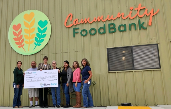 Group at food bank receives grant chack from Bayer Fund