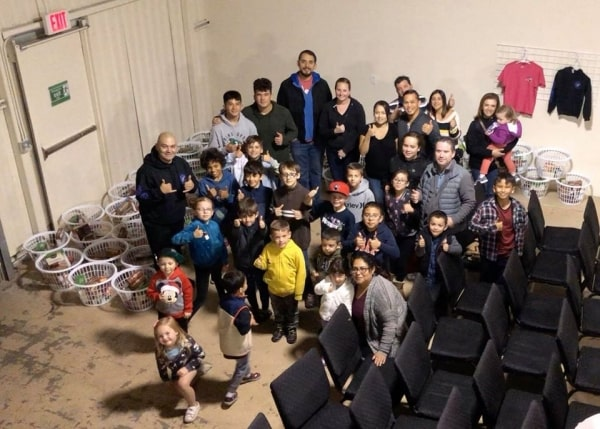 Students and families pose for photo inside Enterprise Martial Arts studio in Hollister, California
