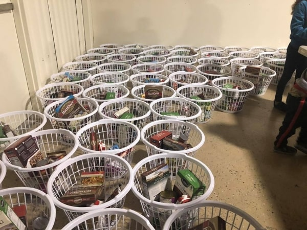 Laundry baskets filled with canned goods and dried foods