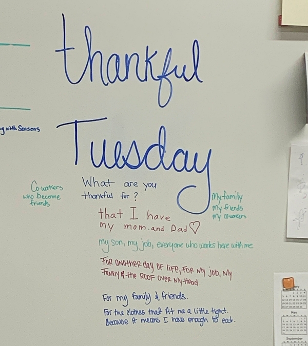 Words of gratitude written on whiteboard at food bank