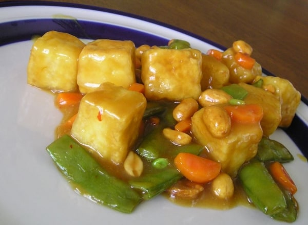 Orange beef-style tofu and vegetables on a plate